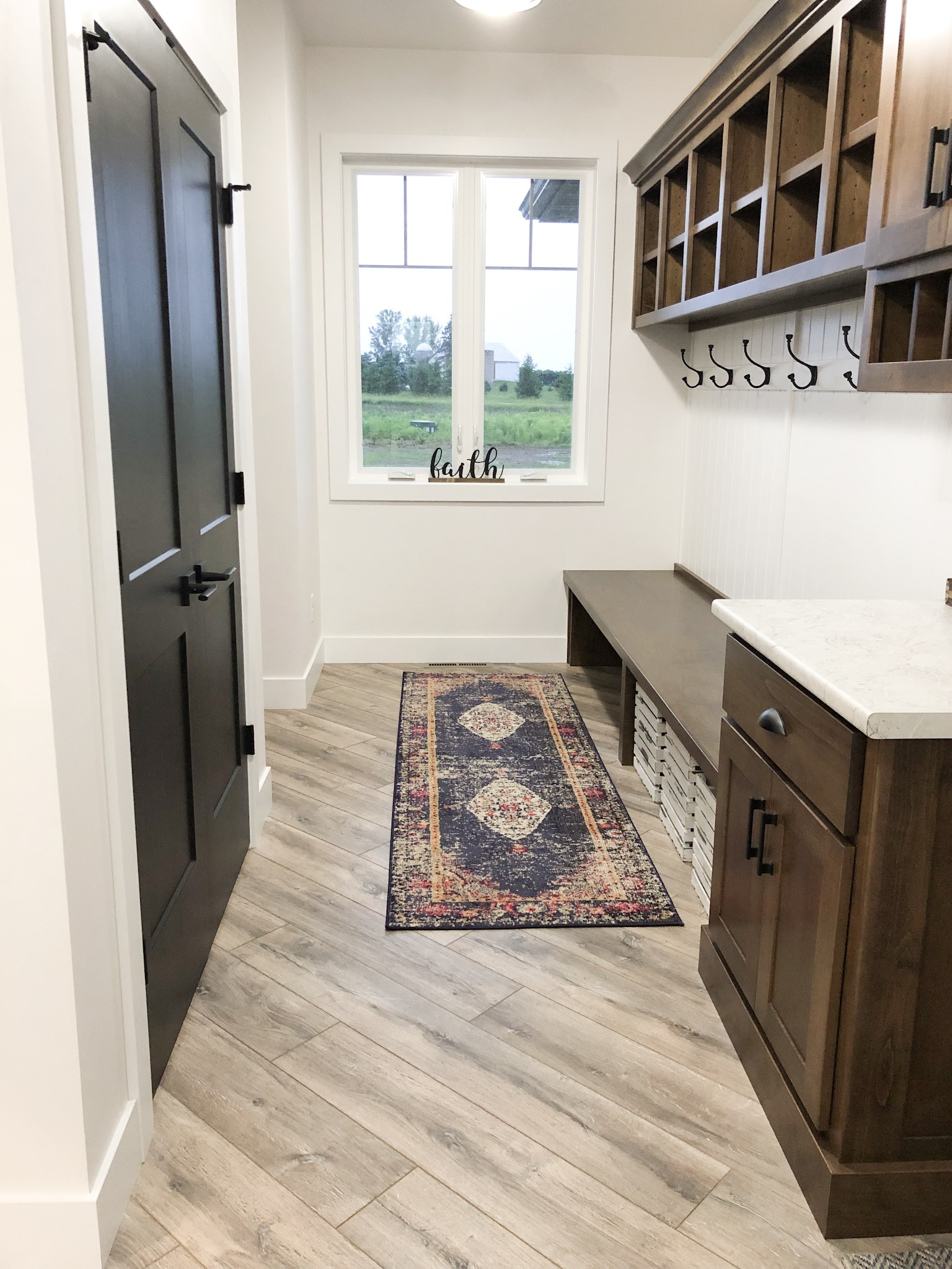 Mudroom with Laminate Fake Wood Floors