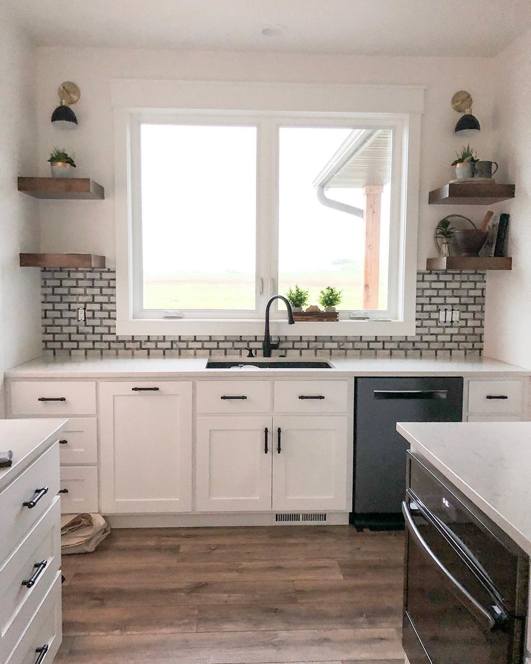 Modern Farmhouse Kitchen with Laminate Wood Flooring